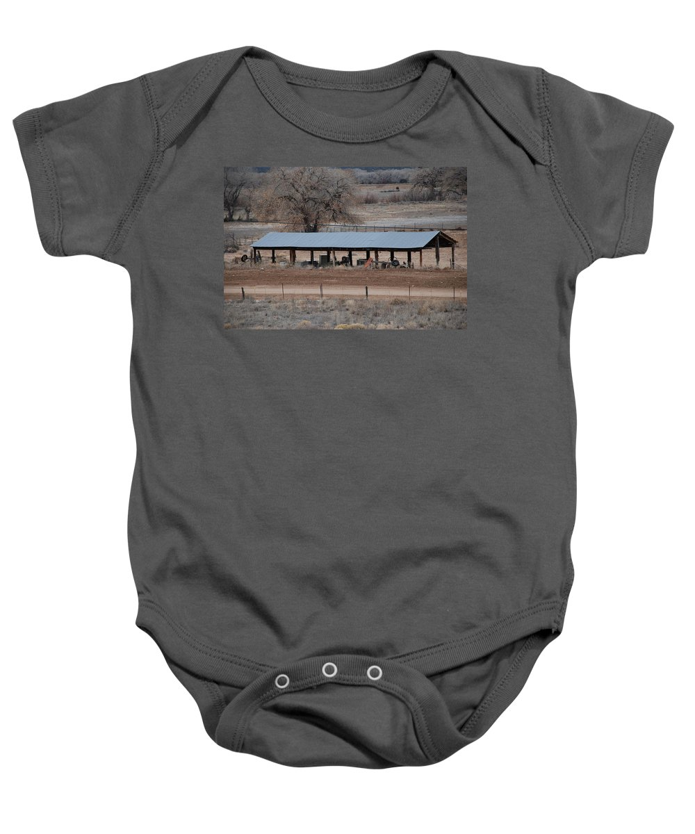Architecture Baby Onesie featuring the photograph Tractor Port On The Ranch by Rob Hans