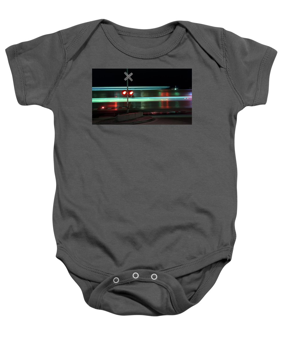 Train Baby Onesie featuring the photograph Train In Motion by Steven Jones