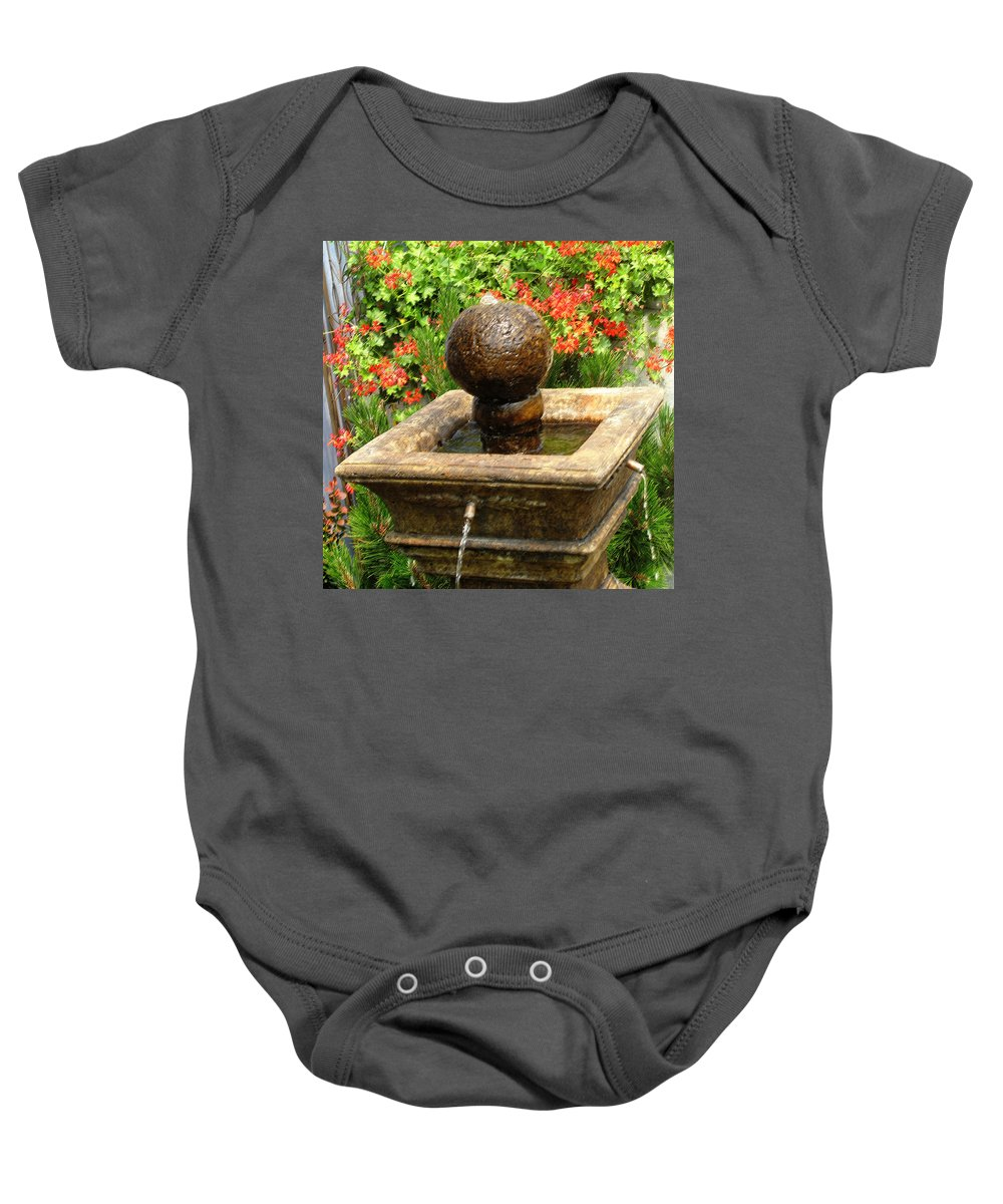 Garden Baby Onesie featuring the photograph Trickle by Ian MacDonald
