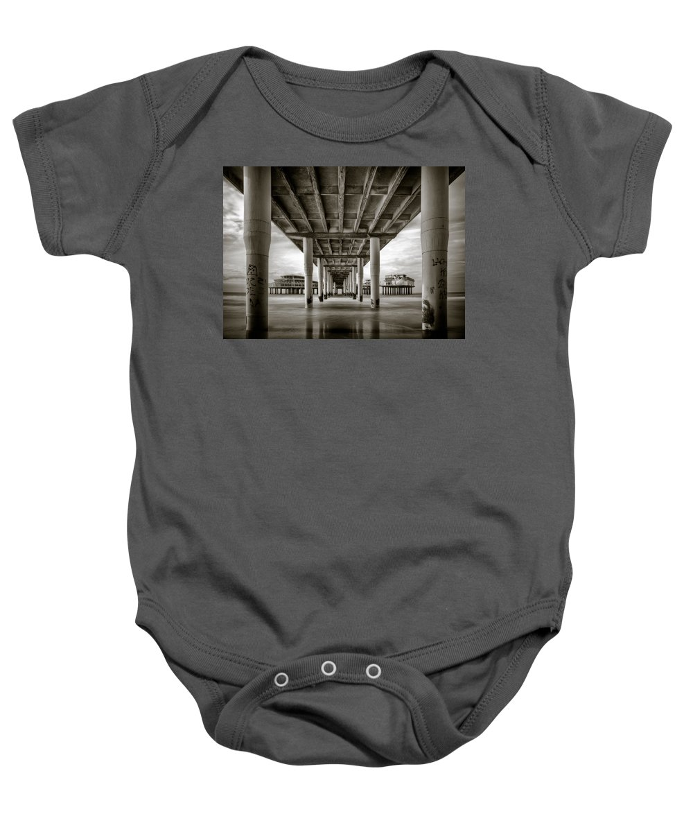 Pier Baby Onesie featuring the photograph Under The Boardwalk by Dave Bowman