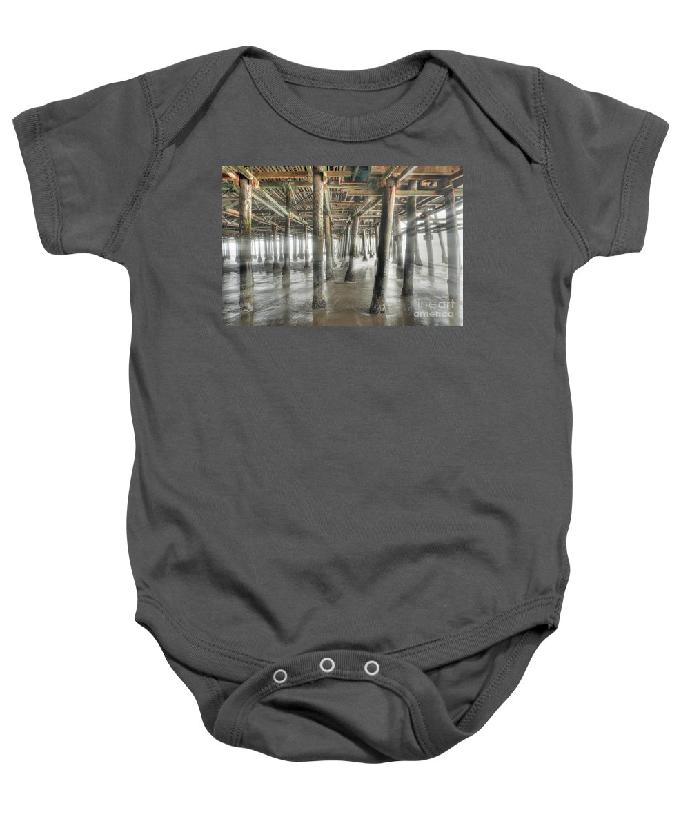 Under The Boardwalk Baby Onesie featuring the photograph Under The Boardwalk Into The Light by David Zanzinger