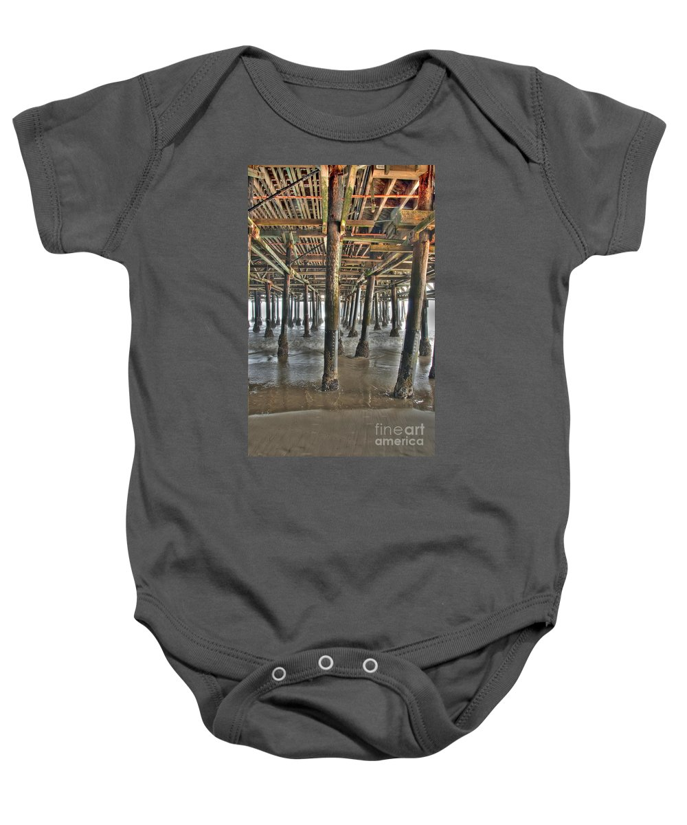 Under The Boardwalk Baby Onesie featuring the photograph Under The Boardwalk Pier Sunbeams by David Zanzinger
