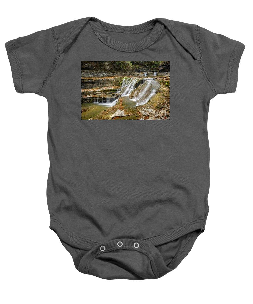 New York Baby Onesie featuring the photograph Upper Gorge Falls Of Enfield Glen In Treman State Park by Karen Jorstad