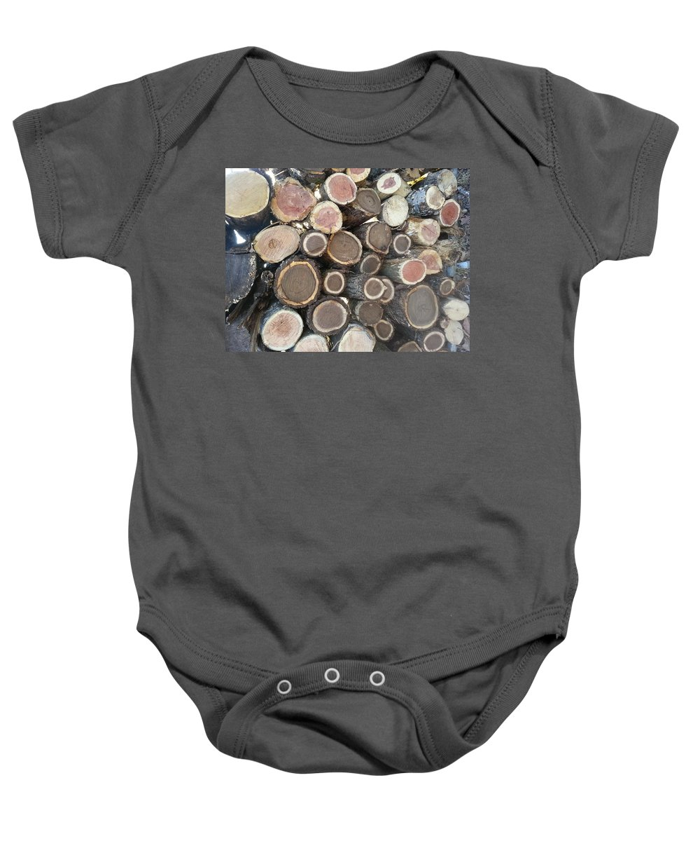 Firewood Baby Onesie featuring the photograph Various Firewood In The Round by Will Dyuran