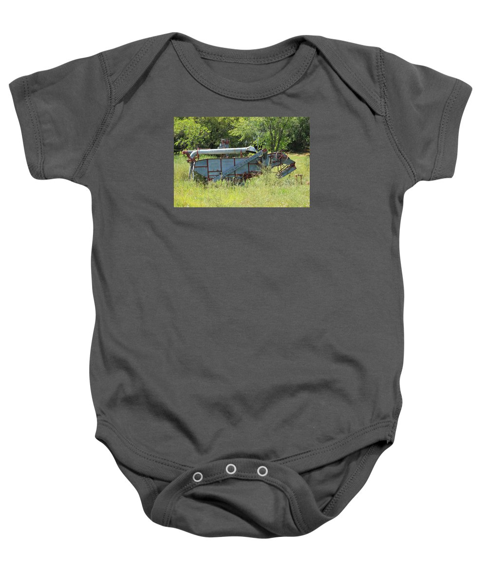 Harvester Baby Onesie featuring the photograph Vintage Harvester In A Field by Robert Hamm