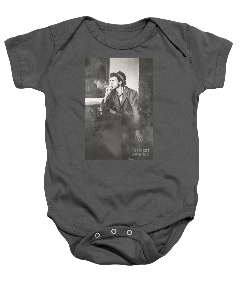 Bar Baby Onesie featuring the photograph Vintage Man In Hat Smoking Cigarette In Jazz Club by Jorgo Photography - Wall Art Gallery