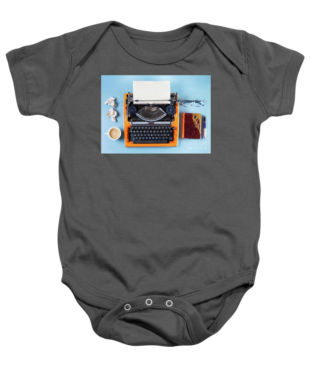 Typewriter Baby Onesie featuring the photograph Everything In Order by Anastasy Yarmolovich