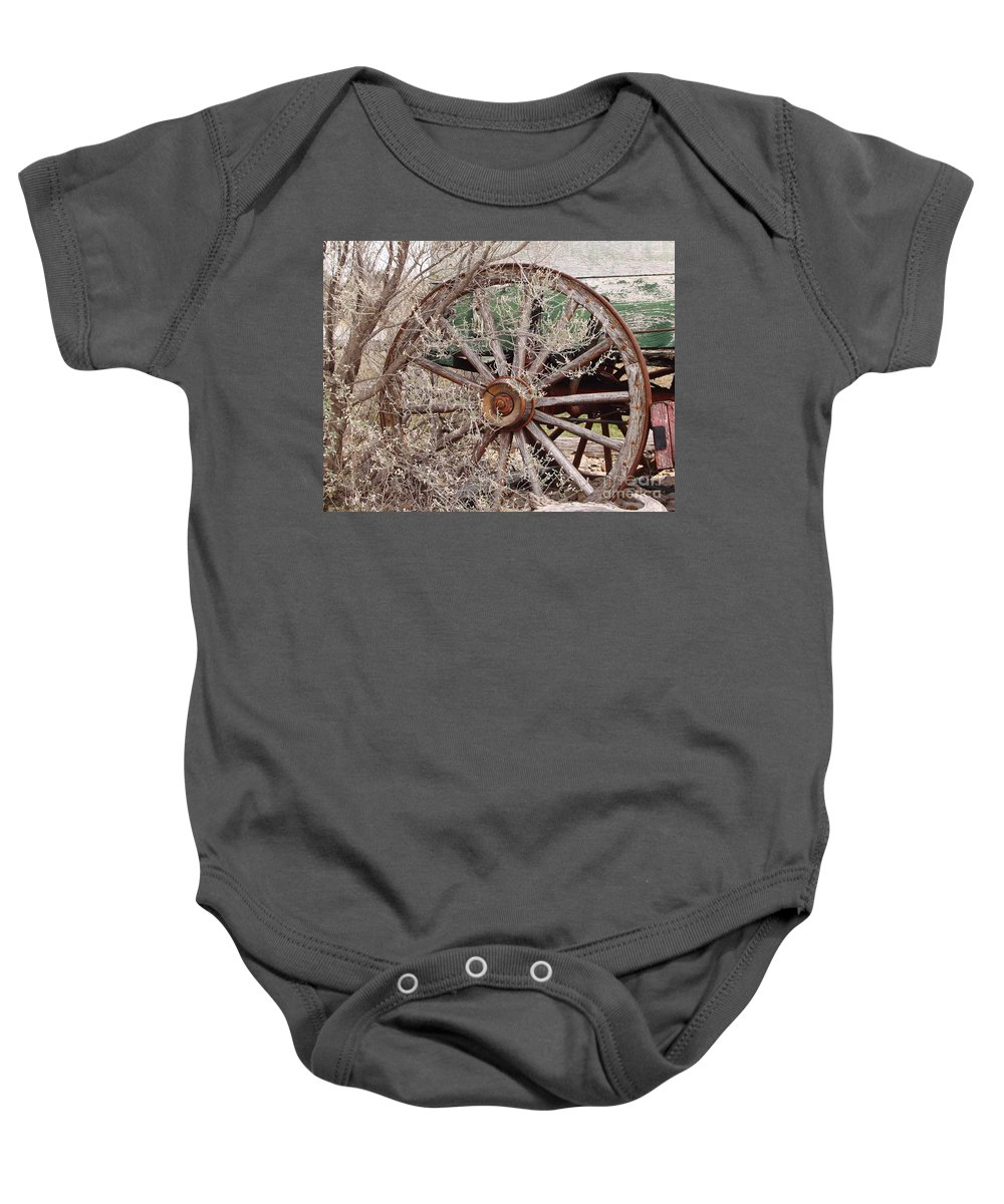 Wagon Baby Onesie featuring the photograph Wagon Wheel by Robert Frederick