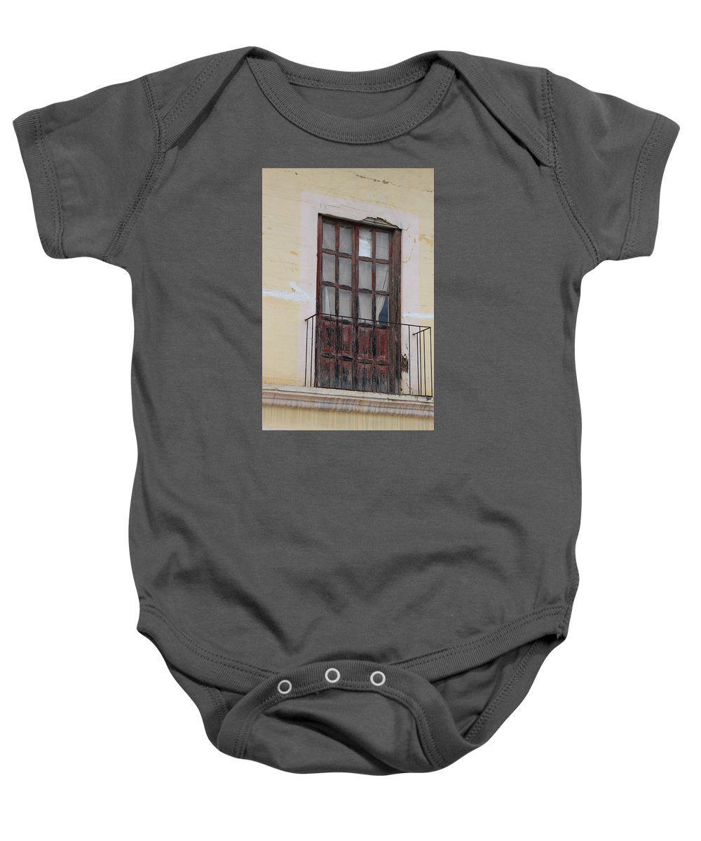 Door Baby Onesie featuring the photograph Weathered Red Door On A Balcony by Robert Hamm