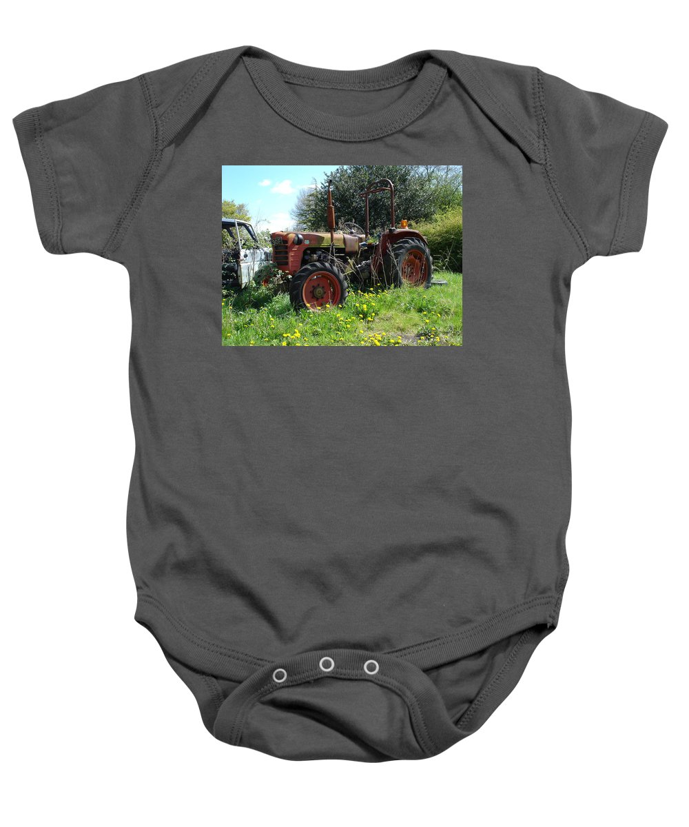 Tractor Baby Onesie featuring the photograph Well And Truely Retired by Susan Baker