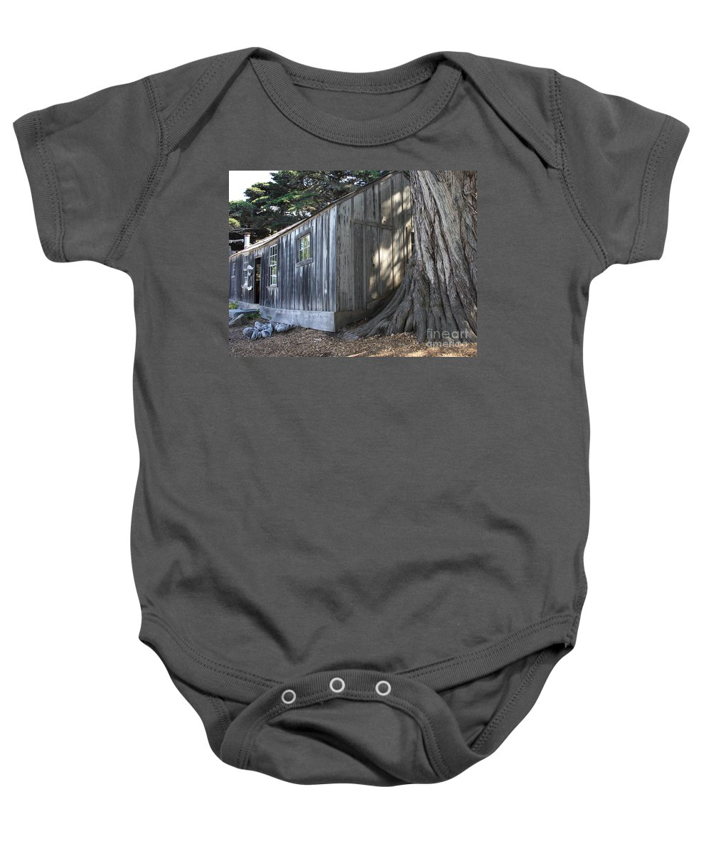 Baby Onesie featuring the photograph Whalers Cabin by Carol Groenen
