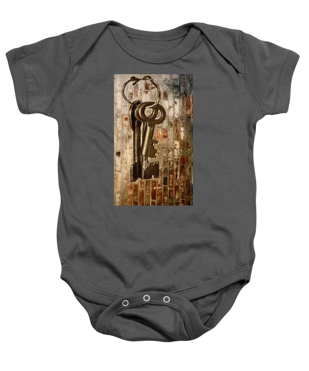 Antiques Baby Onesie featuring the photograph What They Unlock by Charuhas Images