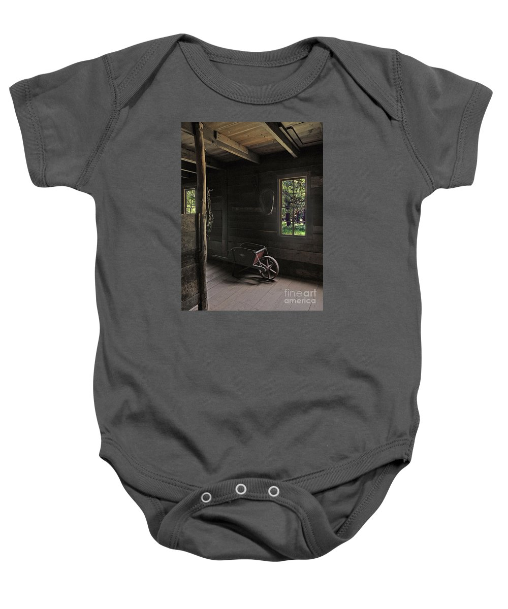 Bradley Baby Onesie featuring the photograph Wheelbarrow In The Light by Rich Despins