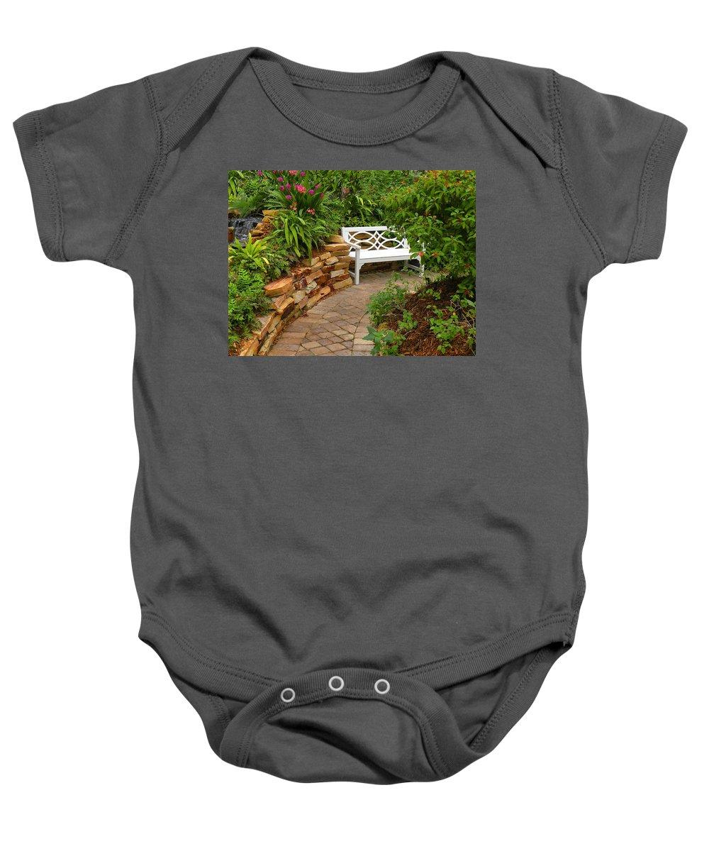 Garden Baby Onesie featuring the photograph White Bench In The Garden by Rosalie Scanlon