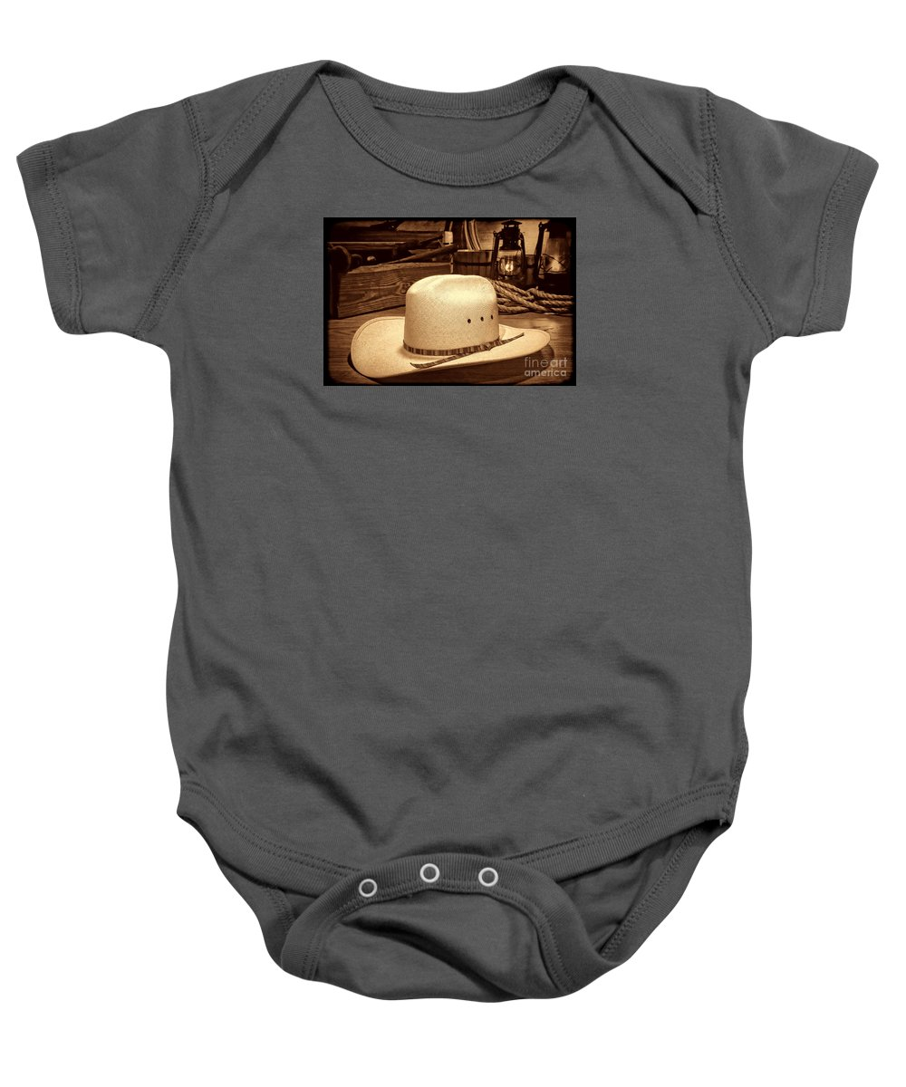 Cowboy Baby Onesie featuring the photograph White Cowboy Hat In A Barn by American West Legend By Olivier Le Queinec