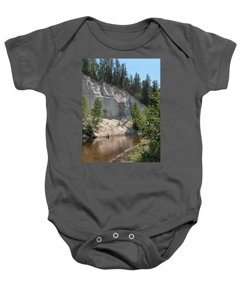 River Sand Cliffs Clear Water Evergreens Trees Natural Beauty Shore Piprell Lake Saskatchewan Baby Onesie featuring the photograph White Sands Cliff by Andrea Lawrence