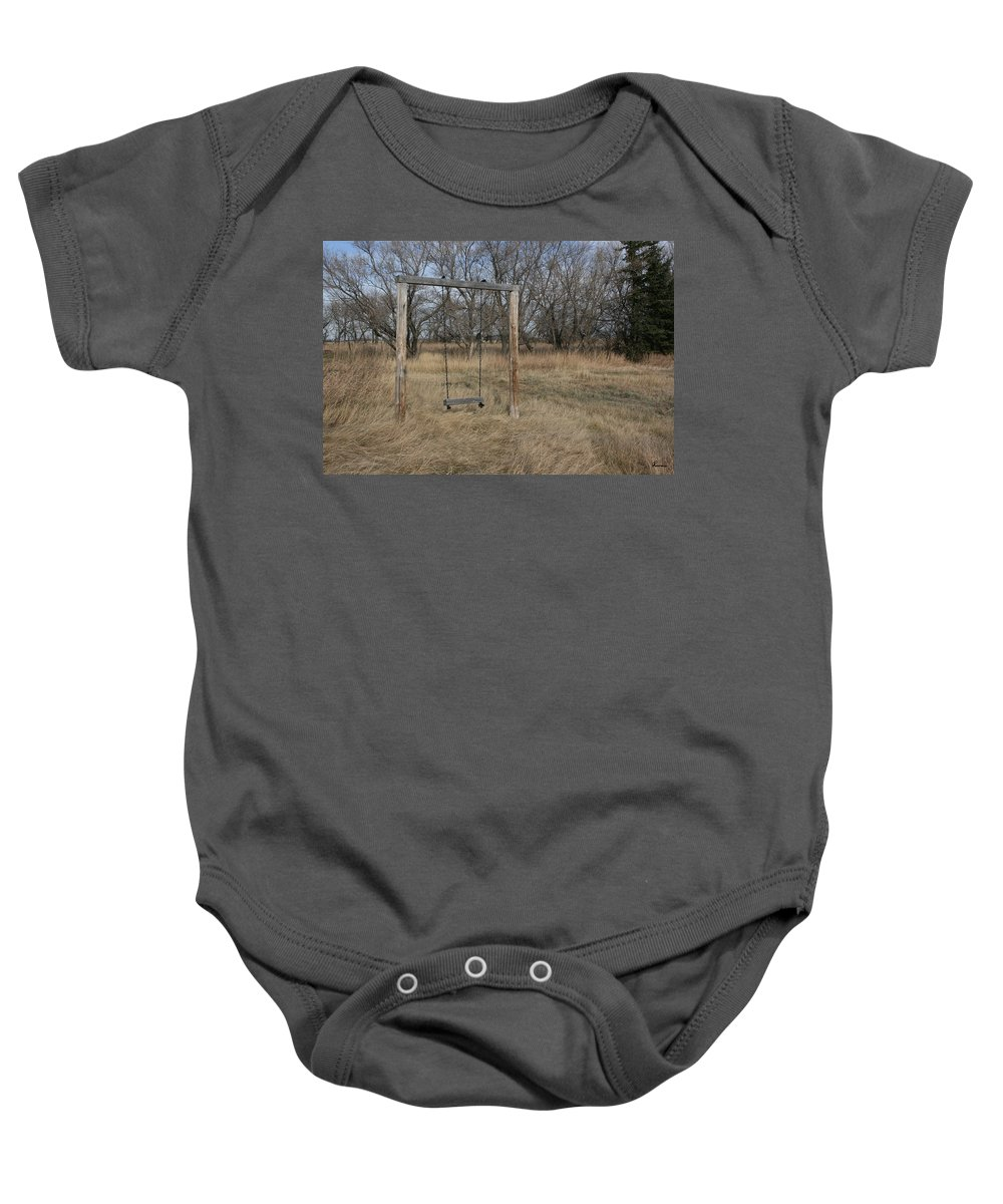 Swing Old Farm Grass Abandoned Trees Playgorund Lost Empty Lonely Baby Onesie featuring the photograph Who Played Here by Andrea Lawrence