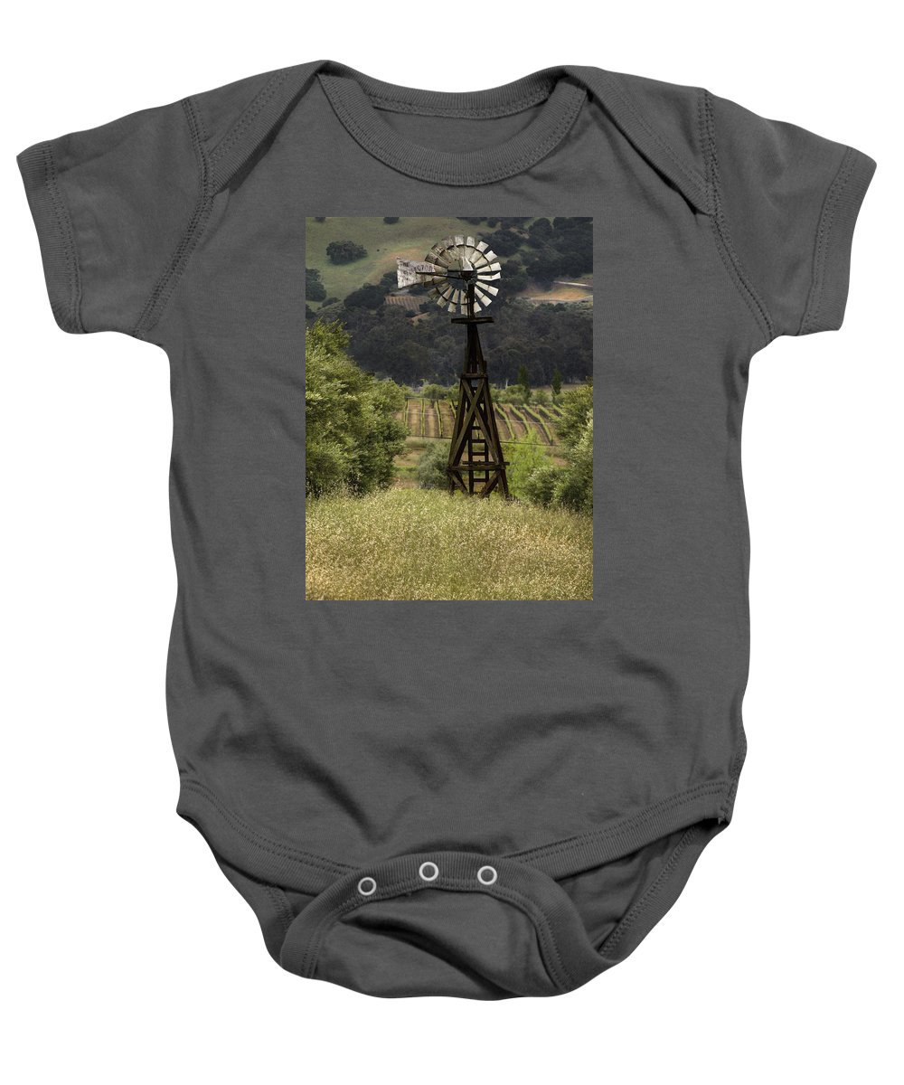 Landscape Baby Onesie featuring the photograph Windmill And Vineyards by Karen W Meyer