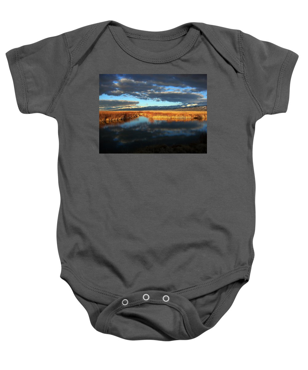 Landscape Baby Onesie featuring the photograph Winter Storm by Linda Arnn Arteno