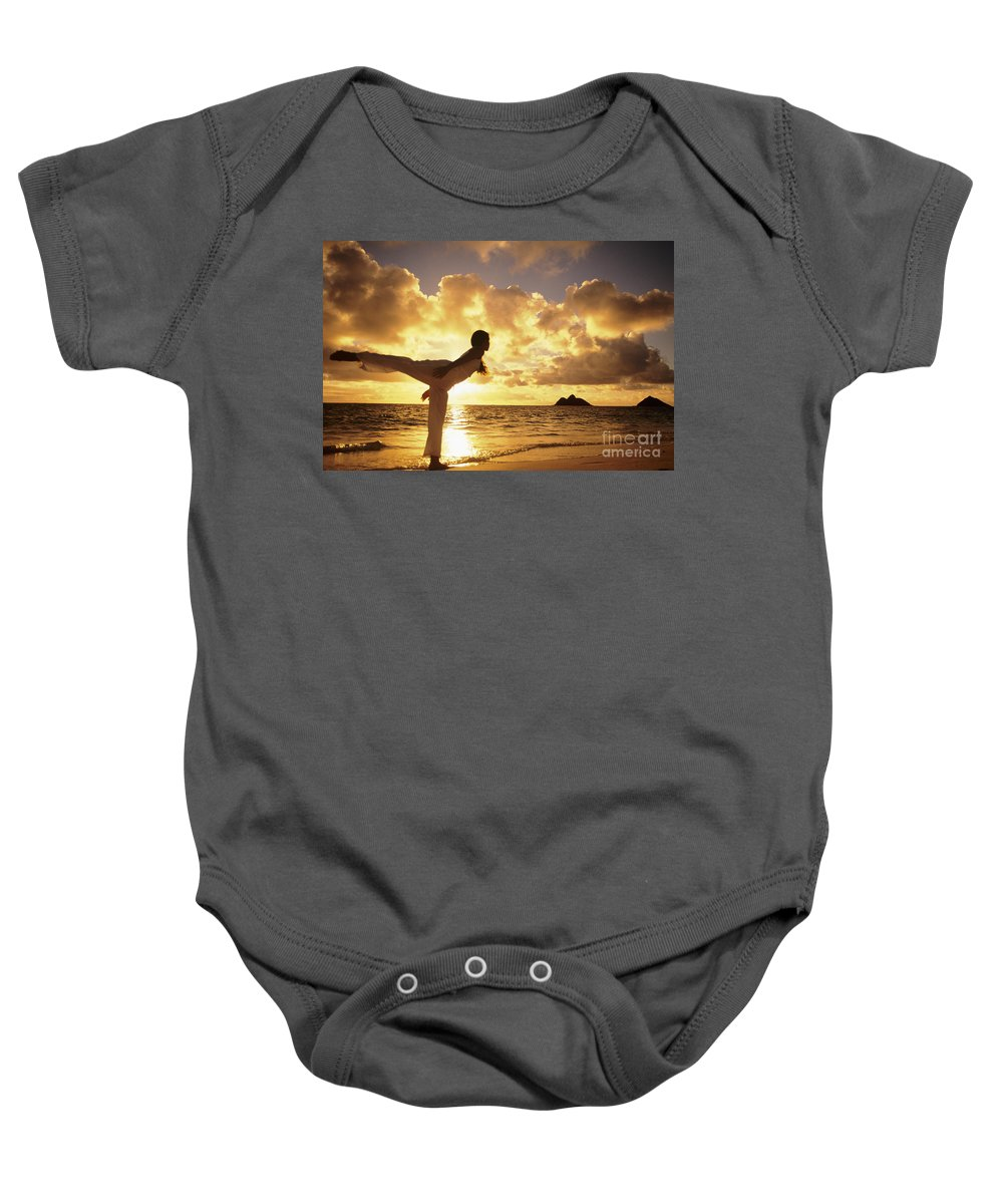 Air Baby Onesie featuring the photograph Woman Doing Yoga On Golden Beach by Dana Edmunds - Printscapes