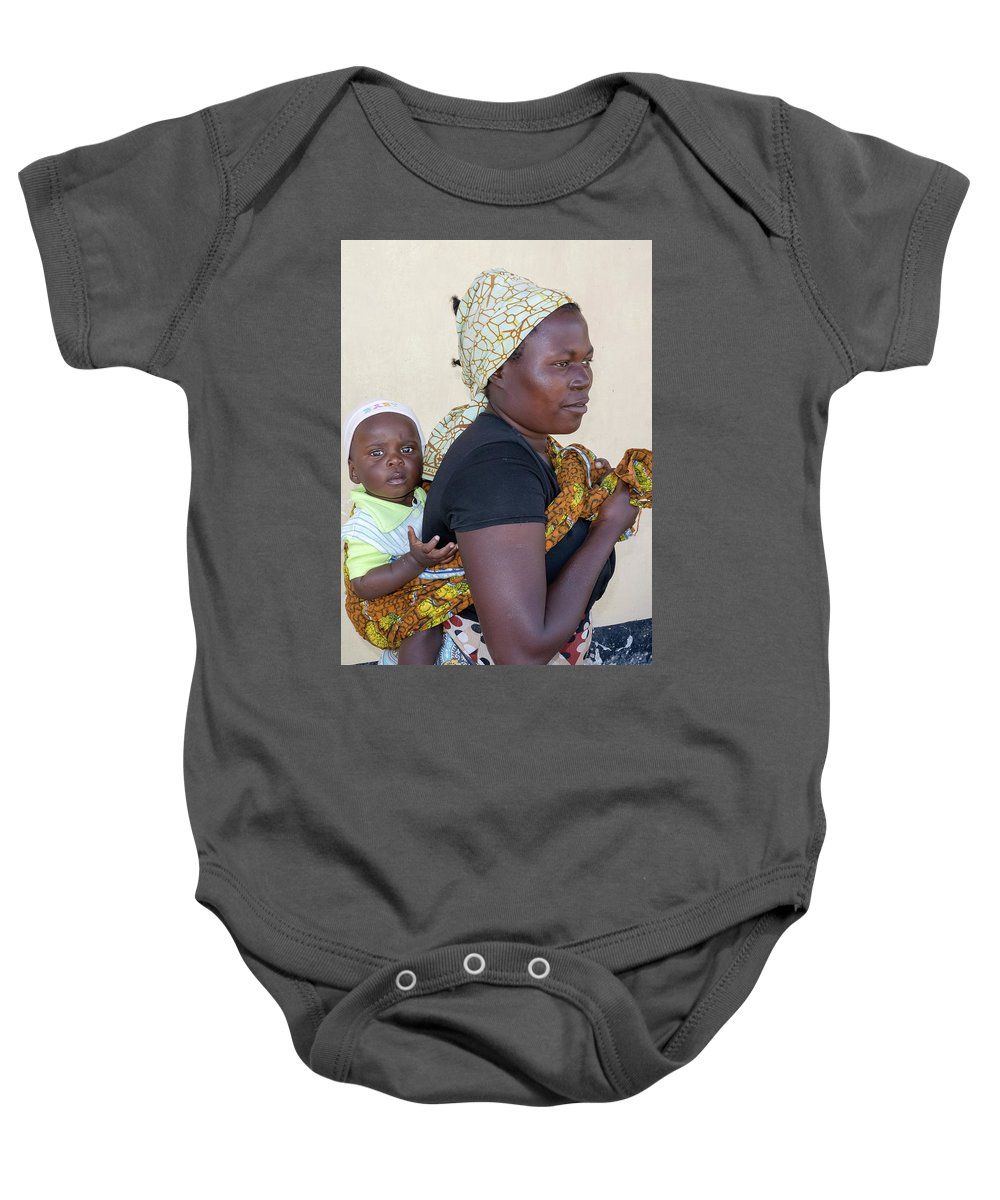 Baby Baby Onesie featuring the photograph Woman With A Baby In Tanzania by Marek Poplawski