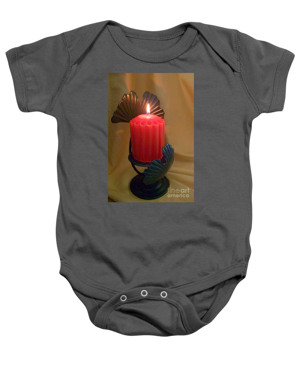 Candle Baby Onesie featuring the photograph Wrapped In A Golden Glow by Mary Deal