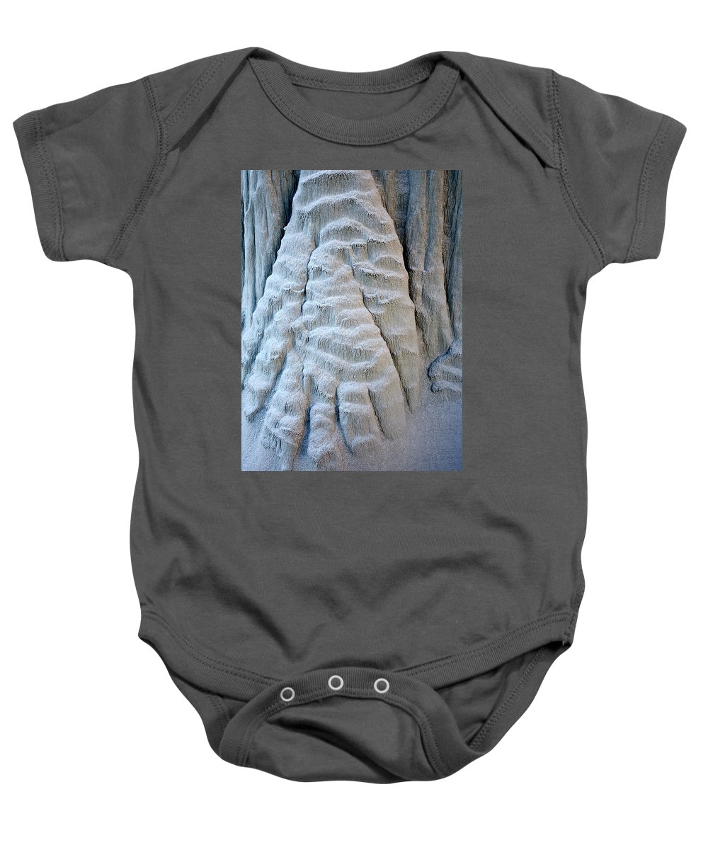 Paw Baby Onesie featuring the photograph Yetti's Paw by Mike Dawson