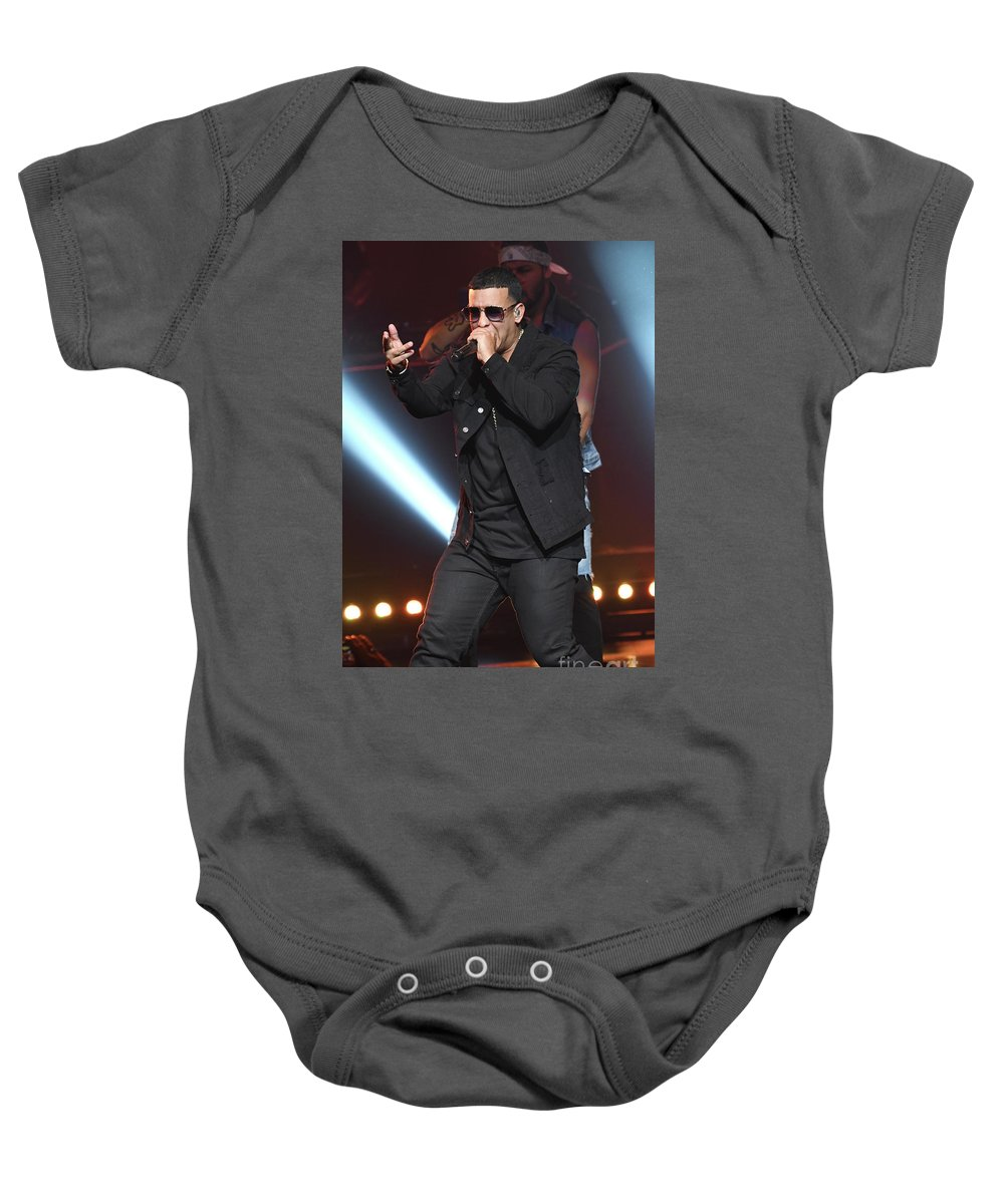 Singer Daddy_yankee Is Shown Performing During A Live Concert Appearance. Baby Onesie featuring the photograph Yankee_daddy by Concert Photos