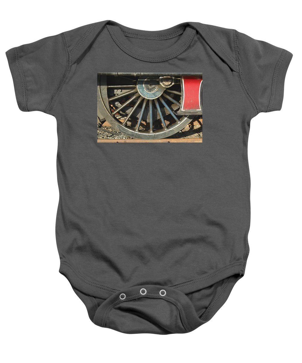 Wheel Baby Onesie featuring the photograph Detail Of Locomotive Wheel With Spokes by Victor Lord Denovan