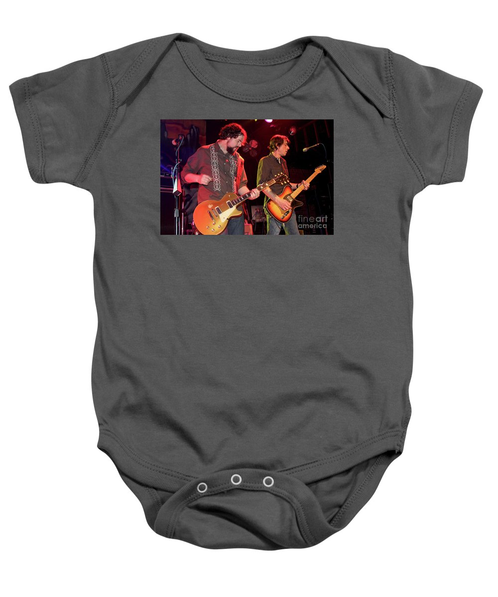 Musicians Patterson Hood Baby Onesie featuring the photograph Drive By Truckers Patterson Hood And Mike Cooley by Concert Photos