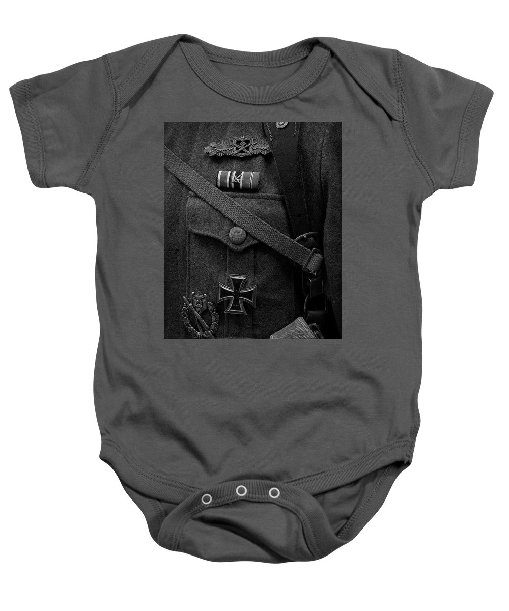 Military Baby Onesie featuring the photograph German Soldier Ww2 Black And White by John Straton