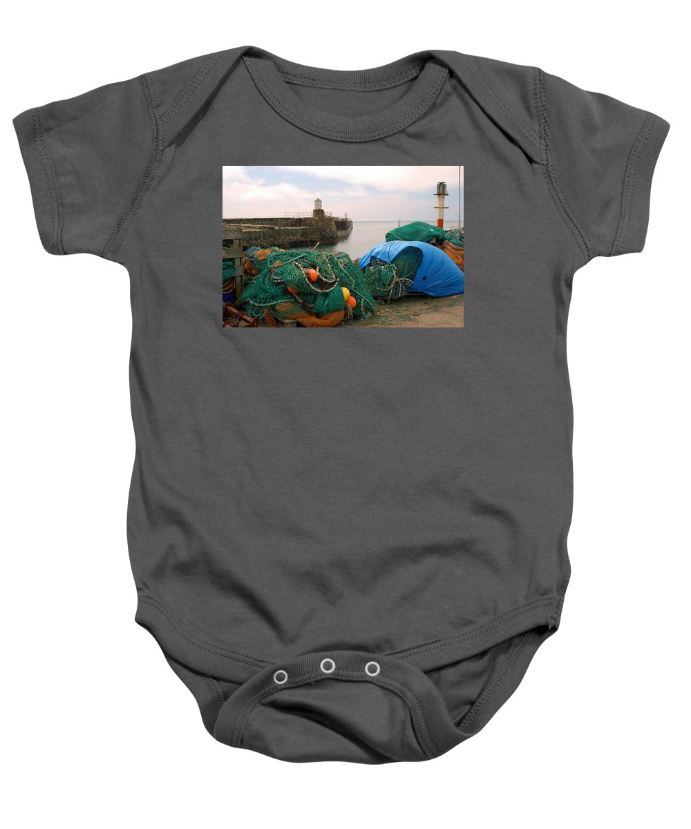 Pittenweem Baby Onesie featuring the photograph harbour pier and fishings nets at Pittenweem, Fife by Victor Lord Denovan
