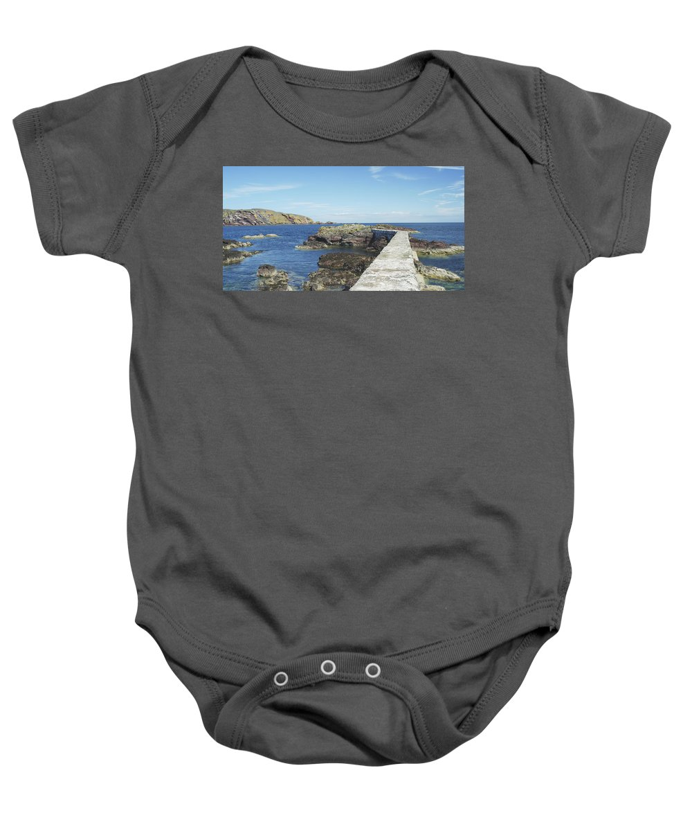 Harbour Baby Onesie featuring the photograph harbour wall and cliffs at St. Abbs, Berwickshire by Victor Lord Denovan