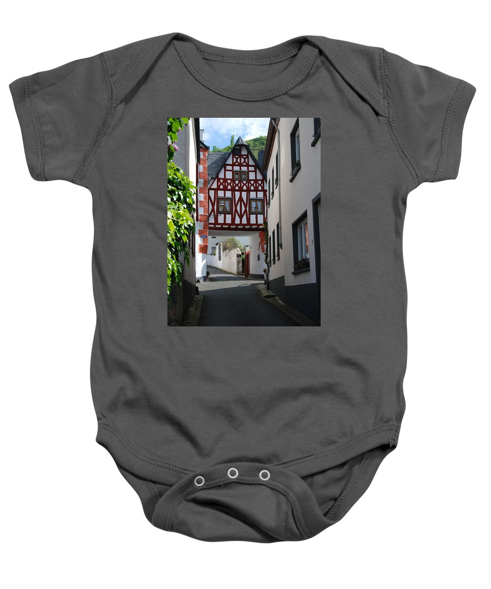 Lane Baby Onesie featuring the photograph old historic street and woodframed house in Ediger Germany by Victor Lord Denovan
