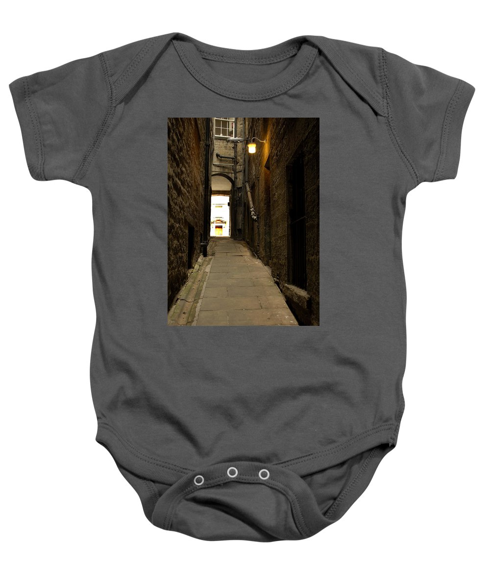 Stone Baby Onesie featuring the photograph old medieval close in Edinburgh by Victor Lord Denovan
