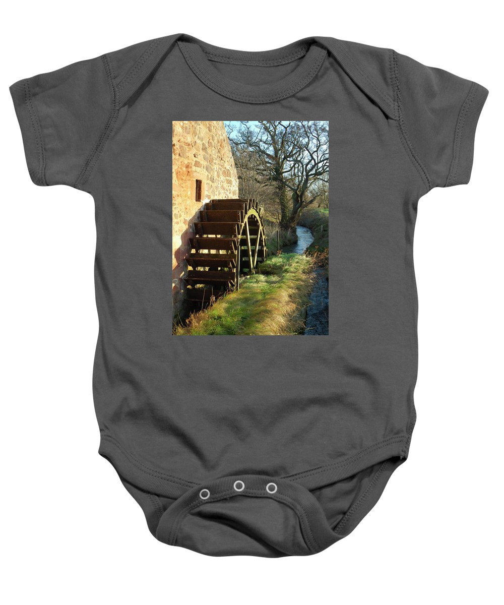Old Baby Onesie featuring the photograph old mill wheel and stream at Preston Mill, East Linton by Victor Lord Denovan
