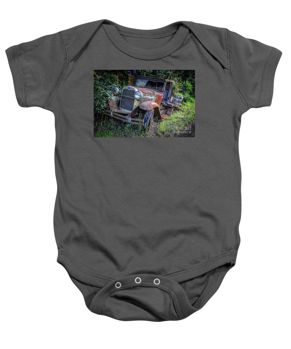 Maui Baby Onesie featuring the photograph Old Model Aa Ford In The Jungle 2 by Edward Fielding