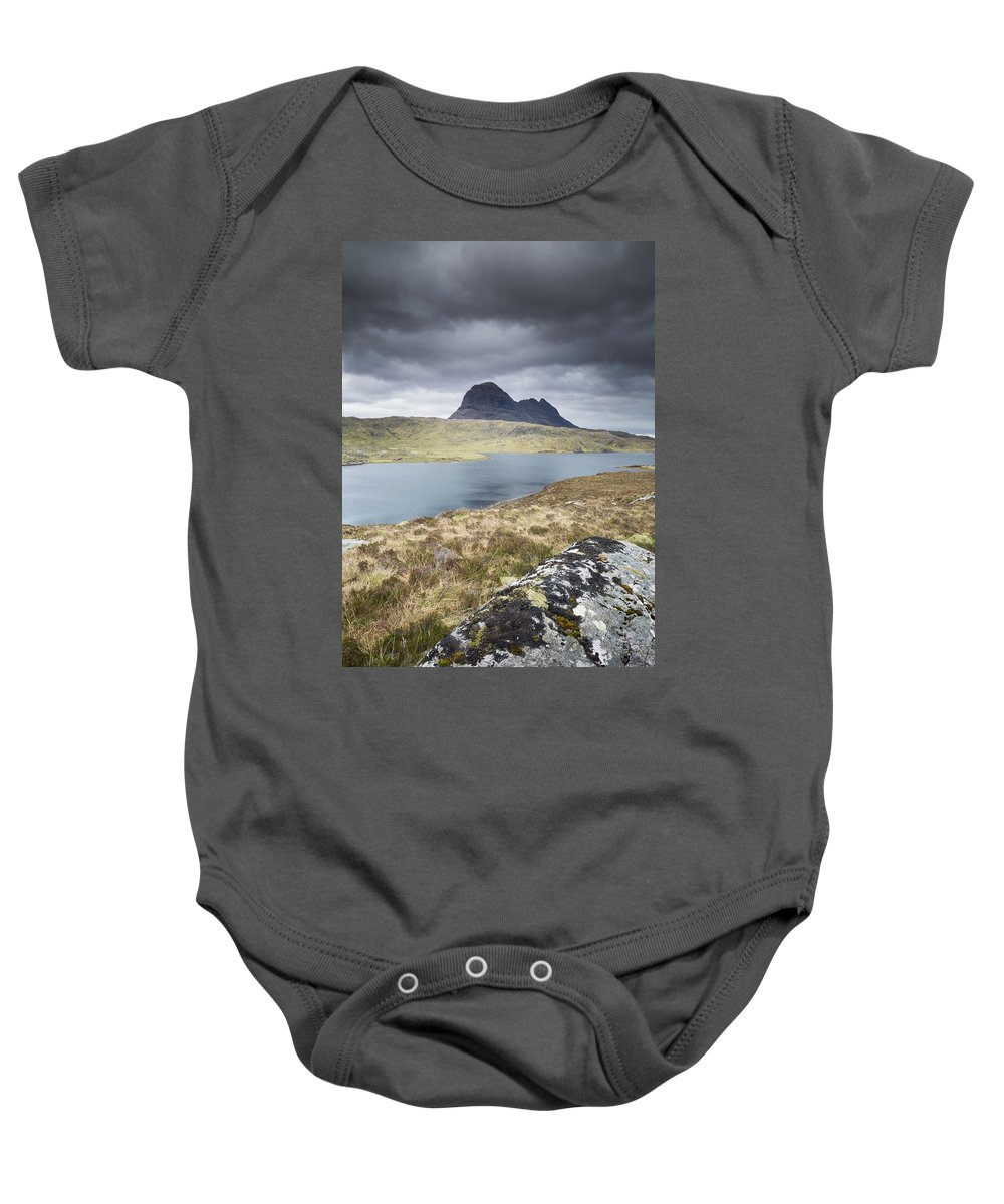 Landscape Baby Onesie featuring the photograph Suilven On A Stormy Day by Anita Nicholson
