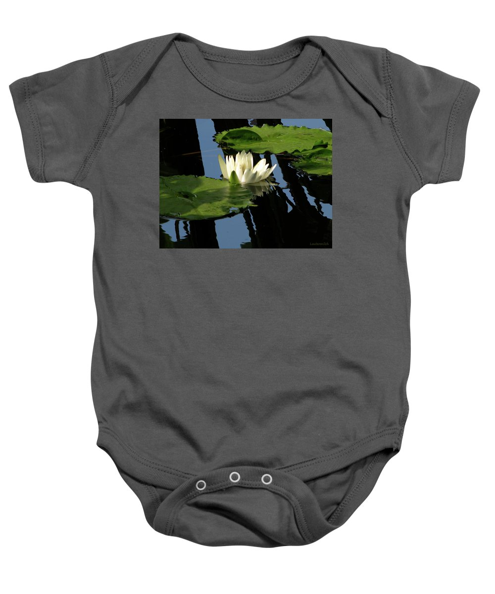 Water Lily Baby Onesie featuring the photograph White on Black by John Lautermilch