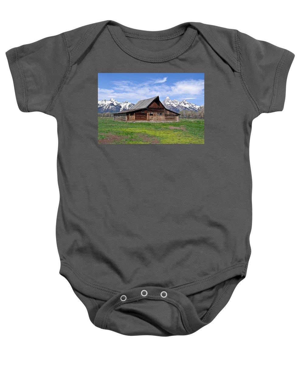 Teton Baby Onesie featuring the photograph Mormon Barn Tetons by Douglas Barnett