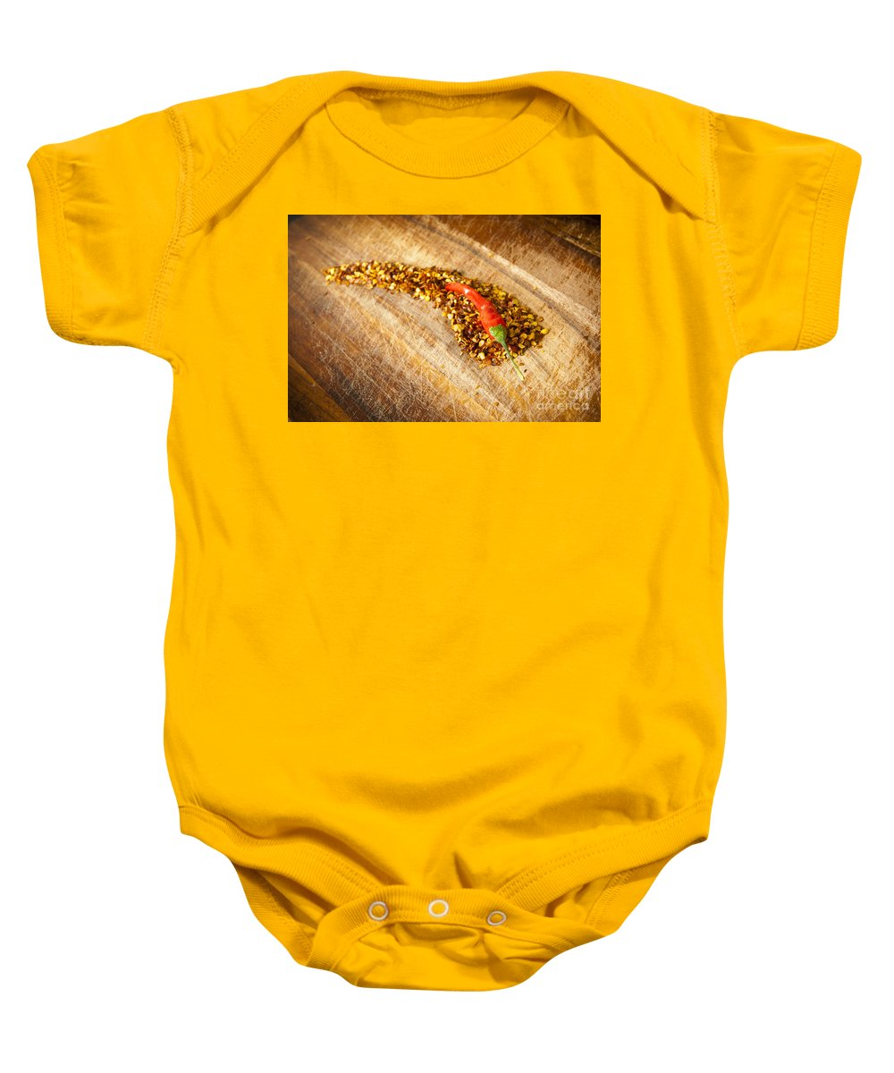Background Baby Onesie featuring the photograph Red Hot Chilli Concept by Tim Hester