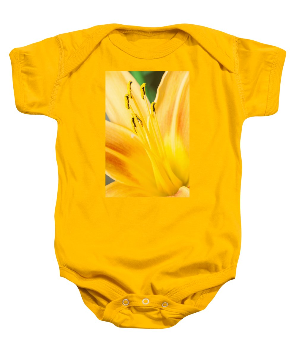 Lily Baby Onesie featuring the photograph Lily by Daniel Csoka
