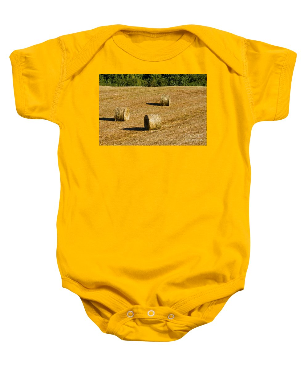 Pesciano Italy Hay Bales Bale Roll Rolls Harvested Farm Farms Farmland Landscape Landscapes Baby Onesie featuring the photograph Bales In The Golden Hour by Bob Phillips