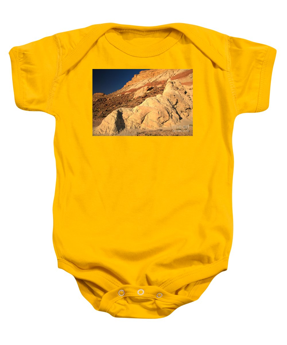 Cottonwood Road Baby Onesie featuring the photograph Cottonwood Colored Badlands by Adam Jewell