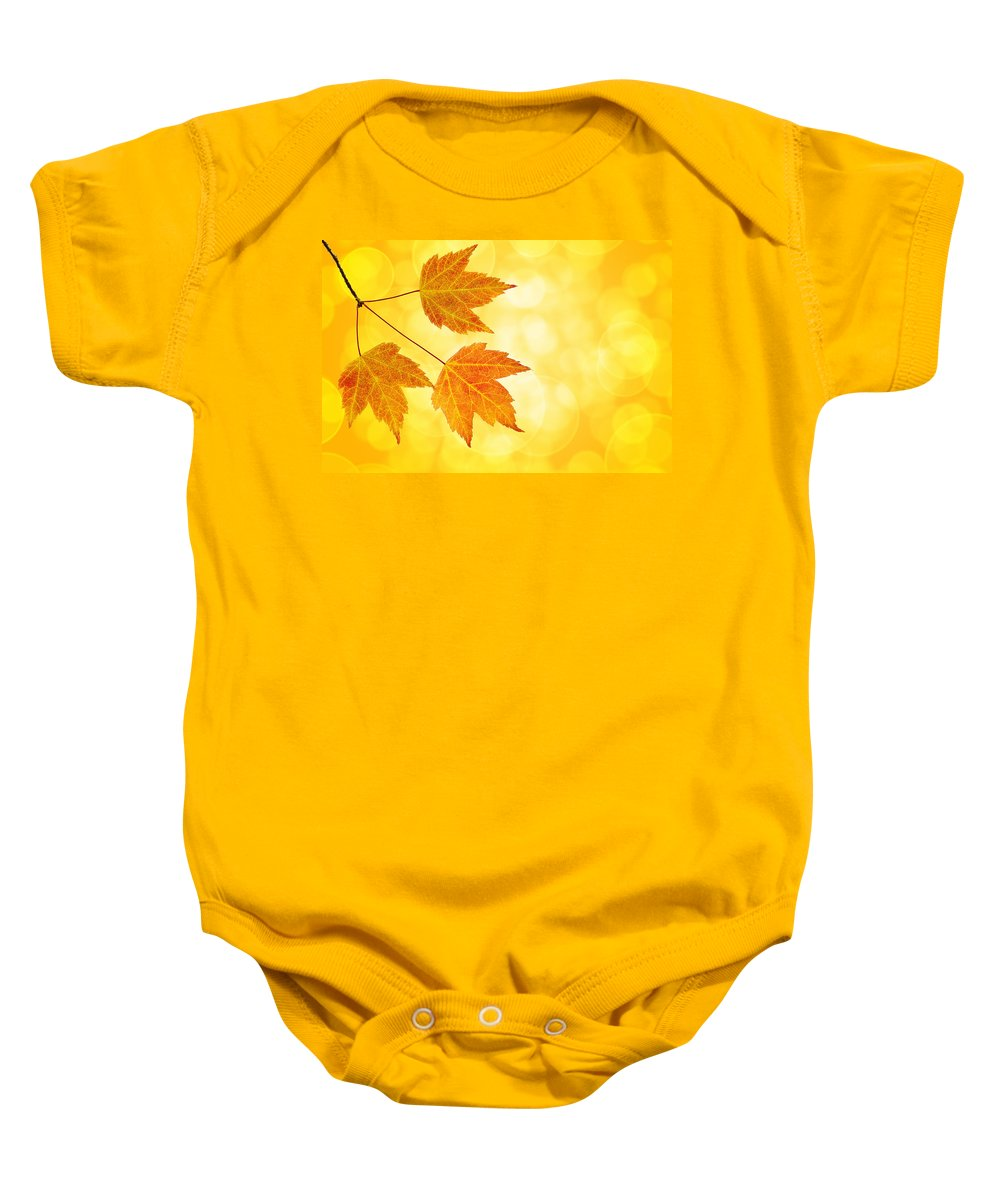 Fall Baby Onesie featuring the photograph Fall Maple Leaves Trio With Bokeh Background by Jit Lim