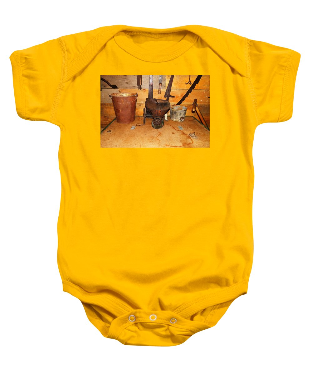 Baby Onesie featuring the photograph Farm Tools by Jeff Swan