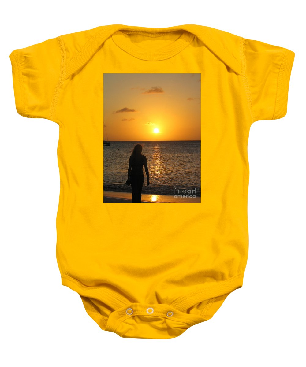 Sunset Baby Onesie featuring the photograph Girl Silhouetted On A Beach At Sunset by DejaVu Designs