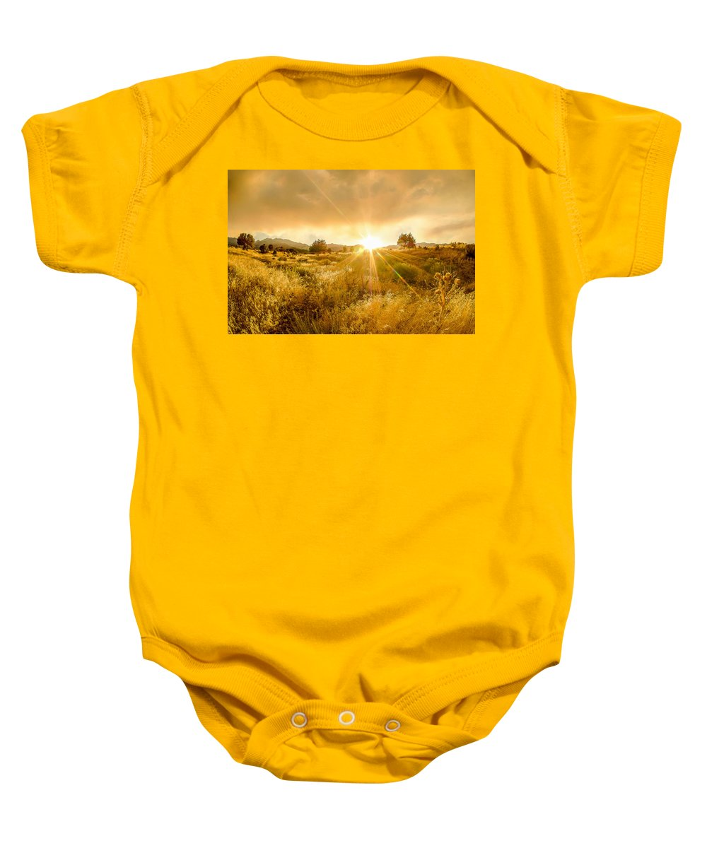 Golden Glow Baby Onesie featuring the photograph Golden Smoke by Emily Dickey