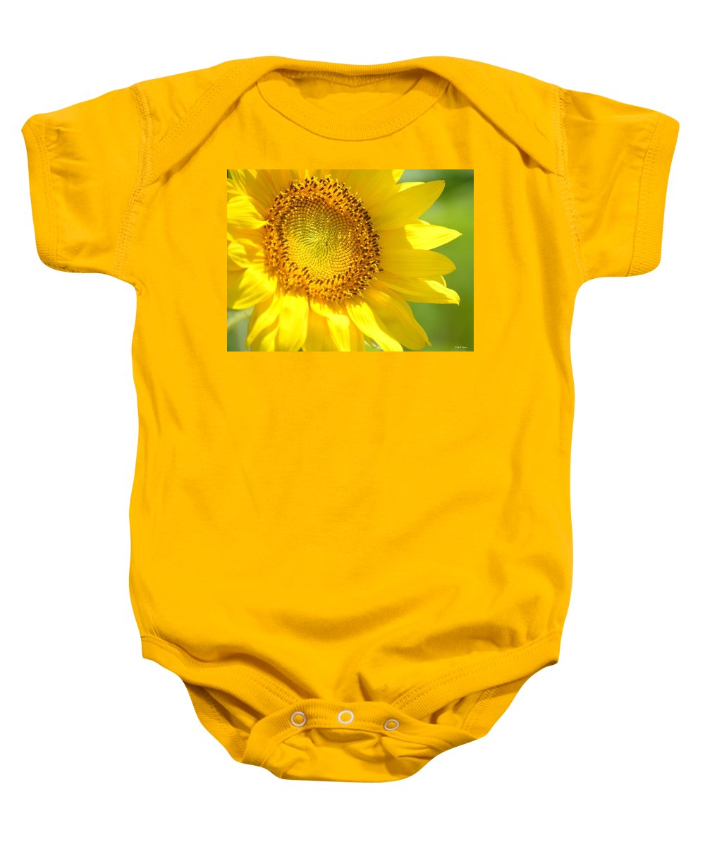 Heart Of The Sunflower Baby Onesie featuring the photograph Heart Of The Sunflower by Maria Urso