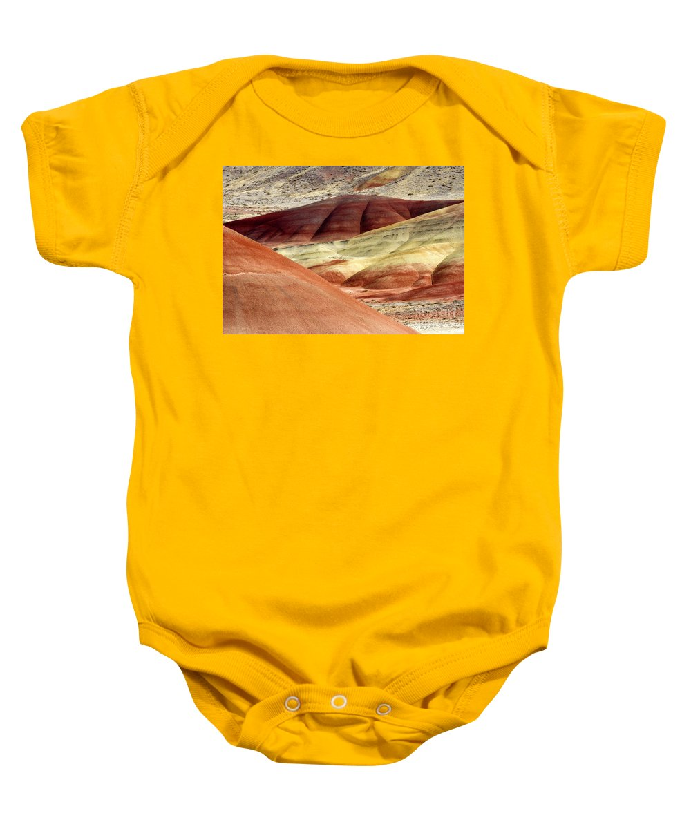 Painted Hills Baby Onesie featuring the photograph Hills Of Red by Mike Dawson